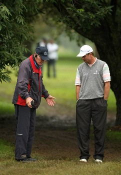 JOHANNESBURG, SOUTH AFRICA - JANUARY 11:  Sven Struver of Germany tries to get relief from a muddy walkway near the 8th green on the East Course during the second round of the Joburg Open 2008 at Royal Johannesburg & Kensington Golf Club on January 11, 2008 in Johannesburg, South Africa.  (Photo by Richard Heathcote/Getty Images)