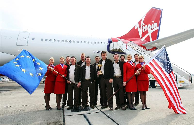 LONDON - SEPTEMBER 15:  Ryder Cup captain Nick Faldo poses with his team, Virgin staff and the Trophy at Heathrow airport before heading to the United States with Team Europe for the Ryder Cup on September 15, 2008 in London, England. The 2008 Ryder Cup will be held at Valhalla Golf Club in Louisville, Kentucky over the weekend of 19-21 September.  (Photo by Andrew Redington/Getty Images)