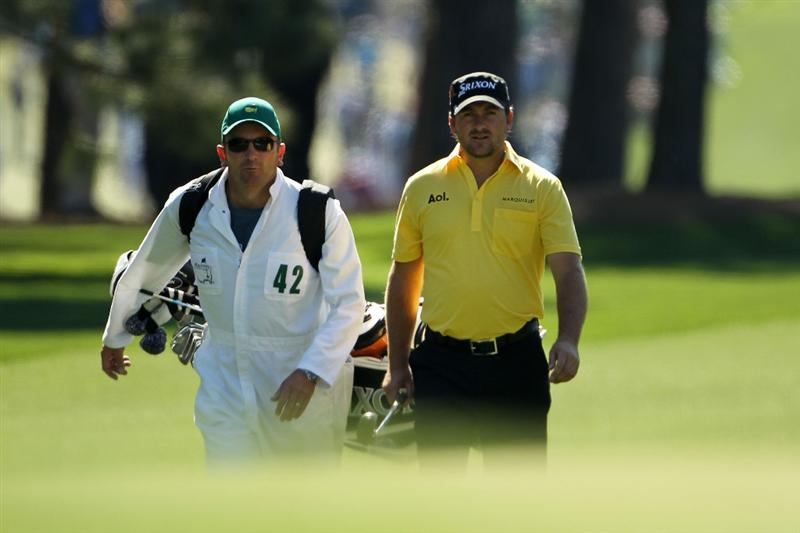 AUGUSTA, GA - APRIL 07:  Graeme McDowell of Northern Ireland walks up the first hole with his caddie Ken Comboy during the first round of the 2011 Masters Tournament at Augusta National Golf Club on April 7, 2011 in Augusta, Georgia.  (Photo by Jamie Squire/Getty Images)