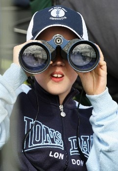 CARNOUSTIE, UNITED KINGDOM - JULY 20:  A young fan watches the play with binoculars during the second round of The 136th Open Championship at the Carnoustie Golf Club on July 20, 2007 in Carnoustie, Scotland.  (Photo by David Cannon/Getty Images)