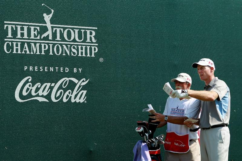 ATLANTA - SEPTEMBER 25:  Jim Furyk (R) talks with his caddie Mike 'Fluff' Cowan as he waits to play his third shot on the 17th hole during the third round of THE TOUR Championship presented by Coca-Cola at East Lake Golf Club on September 25, 2010 in Atlanta, Georgia.  (Photo by Scott Halleran/Getty Images)