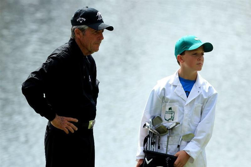 AUGUSTA, GA - APRIL 07:  Gary Player of South Africa waits with his caddie during the Par 3 Contest prior to the 2010 Masters Tournament at Augusta National Golf Club on April 7, 2010 in Augusta, Georgia.  (Photo by David Cannon/Getty Images)