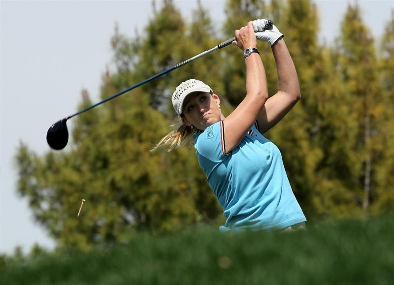 RANCHO MIRAGE, CA - APRIL 2:   Cristie Kerr hits her tee shot on the 11th hole during the second round of the Kraft Nabisco Championship at Mission Hills Country Club on April 2, 2010 in Rancho Mirage, California.  (Photo by Stephen Dunn/Getty Images)