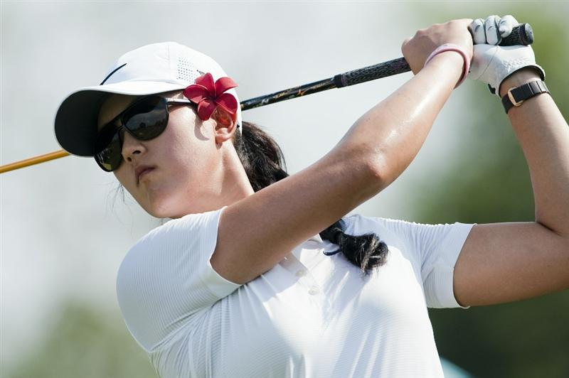 CHON BURI, THAILAND - FEBRUARY 18:  Michelle Wie of USA tees off on the 15th hole during day two of the LPGA Thailand at Siam Country Club on February 18, 2011 in Chon Buri, Thailand.  (Photo by Victor Fraile/Getty Images)