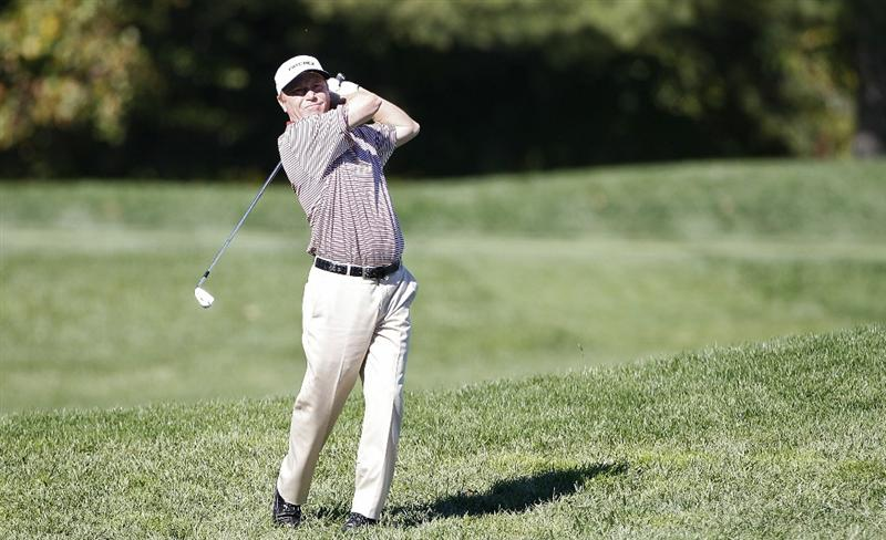 POTOMAC, MD - OCTOBER 08:  Jeff Sluman hits his second shot on the seventh hole from the rough during the second round of the Constellation Energy Senior Players Championship held at TPC Potomac at Avenel Farm on October 8, 2010 in Potomac, Maryland.  (Photo by Michael Cohen/Getty Images)