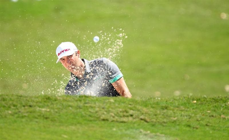 DORAL, FL - MARCH 13: Dustin Johnson hits out of the bunker on the second hole during round three of the 2010 WGC-CA Championship at the TPC Blue Monster at Doral on March 13, 2010 in Doral, Florida.  (Photo by Scott Halleran/Getty Images)