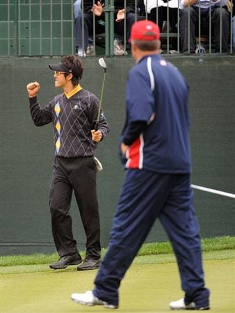 SAN FRANCISCO - OCTOBER 11:  Ryo Ishikawa of the International Team celebrates in front of Kenny Perry of the USA Team to half the 16th hole during the Day Four Singles Matches of The Presidents Cup at Harding Park Golf Course on October 11, 2009 in San Francisco, California.  (Photo by Harry How/Getty Images)