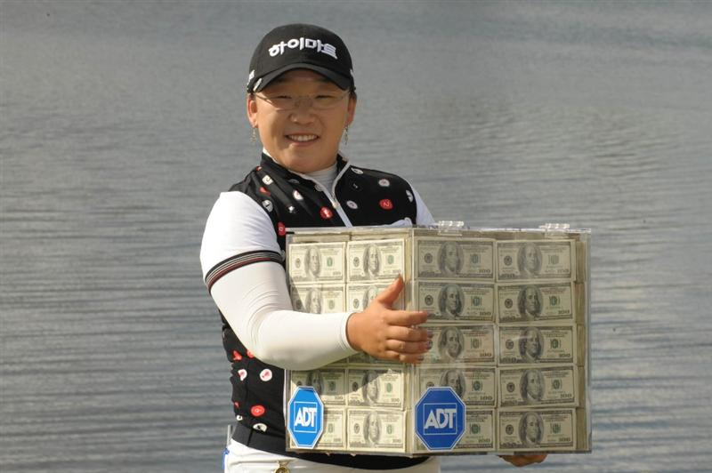 WEST PALM BECH, FL - NOVEMBER 23:  Ji-Yai Shin poses with the million dollar prize after a one-stroke victory at the ADT Championship at the Trump International Golf Club on November 23, 2008 in West Palm Beach Florida.  (Photo by Montana Pritchard/Getty Images)