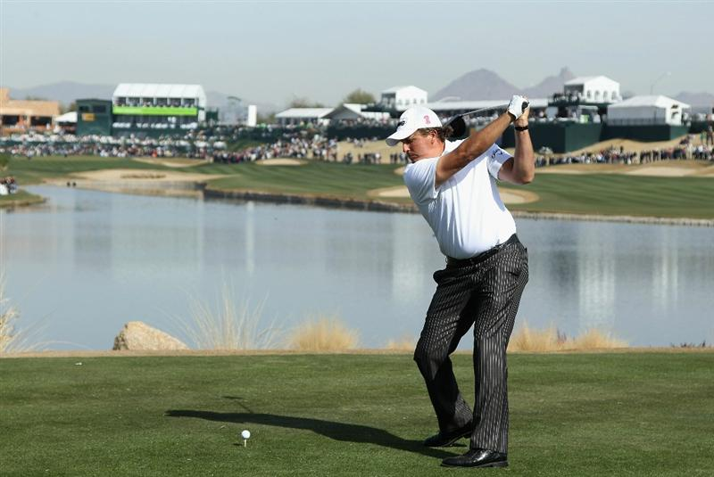 SCOTTSDALE, AZ - FEBRUARY 06:  Phil Mickelson hits a tee shot on the 18th hole during the third round of the Waste Management Phoenix Open at TPC Scottsdale on February 6, 2011 in Scottsdale, Arizona.  (Photo by Christian Petersen/Getty Images)