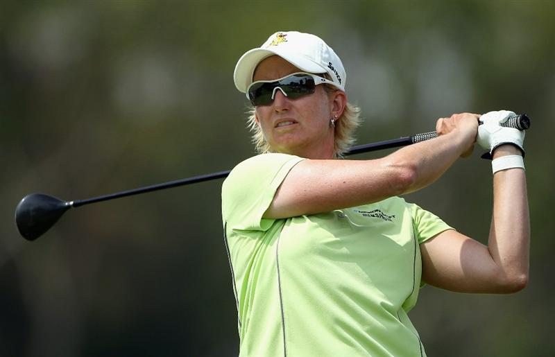 SINGAPORE - FEBRUARY 26:  Karrie Webb of Australia tees off on the 18thh hole during the third round of the HSBC Women's Champions at the Tanah Merah Country Club on February 26, 2011 in Singapore.  (Photo by Andrew Redington/Getty Images)