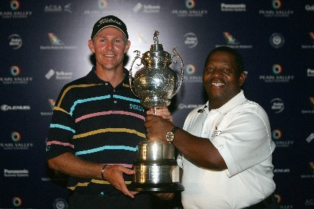 PAARL, SOUTH AFRICA - DECEMBER 16: James Kingston of South Africa (L) is presented with the trophy by Khaya Ngquula, President & CEO of South African Airways, after winning The South African Airways Open on a score of -4 under par at Pearl Valley Golf Club on December 16, 2007 in Paarl, South Africa.  (Photo by Warren Little/Getty Images)