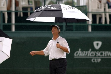 Peter Jacobson checks the rain on the 18th hole  during   the final  round of the 2005 Blue Angels Classic  May 15 in Milton, Fl.Photo by Al Messerschmidt/WireImage.com