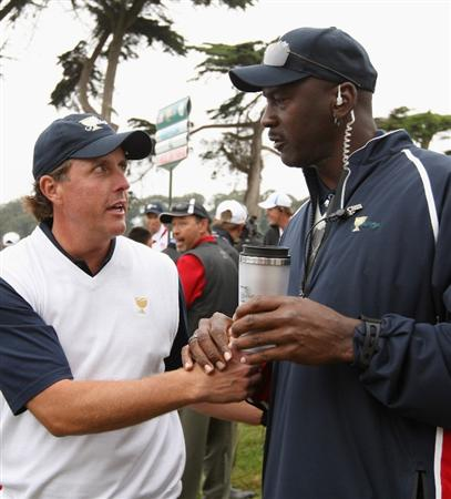 SAN FRANCISCO - OCTOBER 10:  Phil Mickelson of the USA Team chats with Michael Jordan, USA Team assistant during the Day Three Morning Foursomes Matches of The Presidents Cup at Harding Park Golf Course on October 10, 2009 in San Francisco, California.  (Photo by Warren Little/Getty Images)