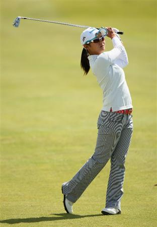 LYTHAM ST ANNES, ENGLAND - AUGUST 02:  Ai Miyazato of Japan hits her second shot on the 4th hole during the final round of the 2009 Ricoh Women's British Open Championship held at Royal Lytham St Annes Golf Club, on August 2, 2009 in Lytham St Annes, England.  (Photo by Warren Little/Getty Images)