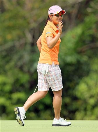 SINGAPORE - FEBRUARY 27:  Ai Miyazato of Japan waves to the crowd after making her birdie putt on the 5th hole during the third round of the HSBC Women's Champions at Tanah Merah Country Club on February 27, 2010 in Singapore, Singapore.  (Photo by Andy Lyons/Getty Images)