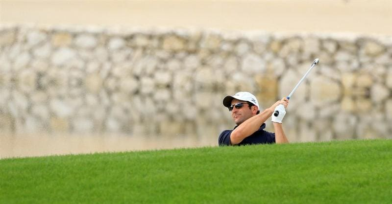 BAHRAIN, BAHRAIN - JANUARY 28:  David Dixon of England plays his second shot at the 17th hole during the second round of the 2011 Volvo Champions held at the Royal Golf Club on January 28, 2011 in Bahrain, Bahrain.  (Photo by David Cannon/Getty Images)