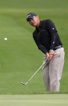 KAWAGOE CITY, JAPAN - OCTOBER 08:  Tze Huang Choo of Singapore hits a chip shot on the 7th hole during the second round of the 2010 Asian Amateur Championship at Kasumigaseki Country Club on October 8, 2010 in Kawagoe City, Japan.  (Photo by Streeter Lecka/Getty Images)