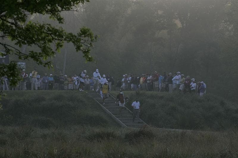 HUMBLE, TX - APRIL 01:  Players walk off the 10th tee box after  fog delays the second round of the Shell Houston Open at Redstone Golf Club on April 1, 2011 in Humble, Texas.  (Photo by Michael Cohen/Getty Images)