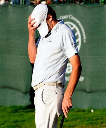 DORAL, FL - MARCH 15:  Nick Watney covers his face  after missing a birdie putt on the 18th hole during the final round of the World Golf Championships-CA Championship at the Doral Golf Resort & Spa on March 15, 2009 in Doral, Florida.  (Photo by Sam Greenwood/Getty Images)