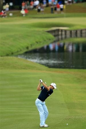 PONTE VEDRA BEACH, FL - MAY 15:  Martin Kaymer of Germany hits an approach shot on the 16th hole during the continuation of the third round of THE PLAYERS Championship held at THE PLAYERS Stadium course at TPC Sawgrass on May 15, 2011 in Ponte Vedra Beach, Florida.  (Photo by Mike Ehrmann/Getty Images)
