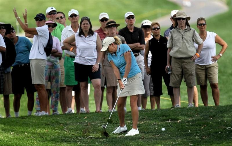 RANCHO MIRAGE, CA - APRIL 02:  Cristie Kerr punches her ball out of the rough on the 15th hole during the second round of the Kraft Nabisco Championship at Mission Hills Country Club on April 2, 2010 in Rancho Mirage, California.  (Photo by Stephen Dunn/Getty Images)