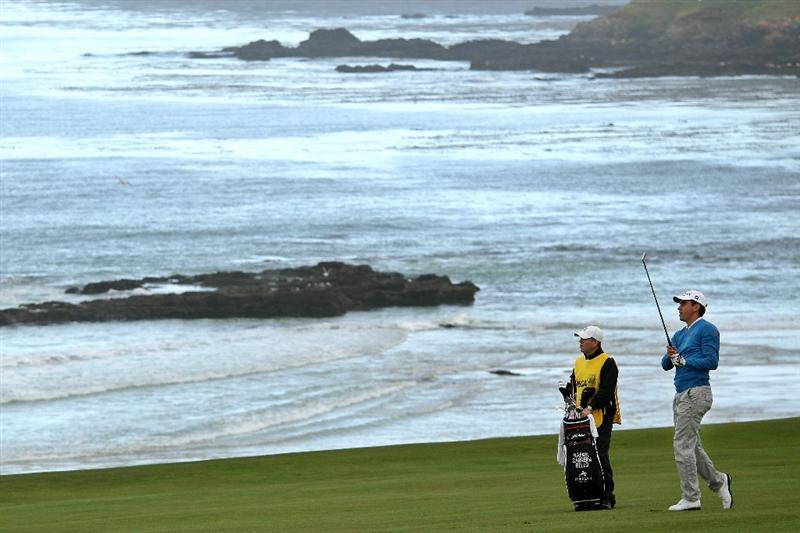 PEBBLE BEACH, CA - JUNE 17:  Rafael Cabrera-Bello of Spain (R) hits a shot on the tenth hole as he caddie Kevin Norks looks on during the first round of the 110th U.S. Open at Pebble Beach Golf Links on June 17, 2010 in Pebble Beach, California.  (Photo by Andrew Redington/Getty Images)