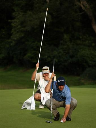 PACIFIC PALISADES, CA - FEBRUARY 20:  Scott McCarron and caddie line up a birdie putt attempt on the 12th hole during the second round of the Northern Trust Open on February 20, 2009 at Riviera Country Club in Pacific Palisades. California.  (Photo by Stephen Dunn/Getty Images)