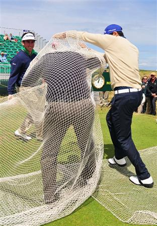 TURNBERRY, SCOTLAND - JULY 14:  Martin Kaymer of Germany is wrapped in a net by his playing partners Stephan Gross, Gonzalo Fernandez-Castano and Alvaro Quiros during a practice round prior to the 138th Open Championship on the Ailsa Course, Turnberry Golf Club on July 14, 2009 in Turnberry, Scotland.  (Photo by Stuart Franklin/Getty Images)