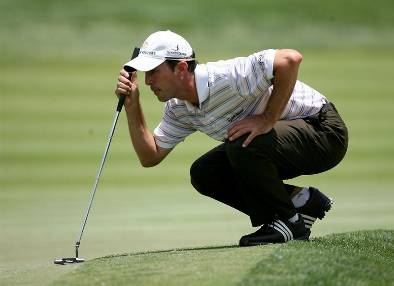 DUBLIN, OH - JUNE 06:  Mike Weir of Canada lines up a putt on the fourth hole during the third round of the Memorial Tournament on June 6, 2009 at the Muirfield Village Golf Club in Dublin, Ohio.  (Photo by Andy Lyons/Getty Images)