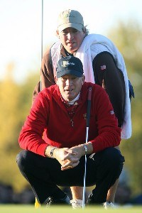 Woody Austin of the U.S. Team lines up a putt with his caddie Brent Henley on the second green during the round three morning foursome matches at The Presidents Cup at The Royal Montreal Golf Club on September 29, 2007 in Montreal, Quebec, Canada. PGA TOUR - 2007 The Presidents Cup - Third RoundPhoto by Scott Halleran/WireImage.com