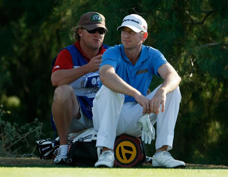 LA QUINTA, CA - JANUARY 24:  Vaughn Taylor and his caddie wait to hit on the 16th tee during the fourth round of the Bob Hope Chrysler Classic at the Nicklaus Course at PGA West on January 24, 2009 in La Quinta, California.  (Photo by Jeff Gross/Getty Images)