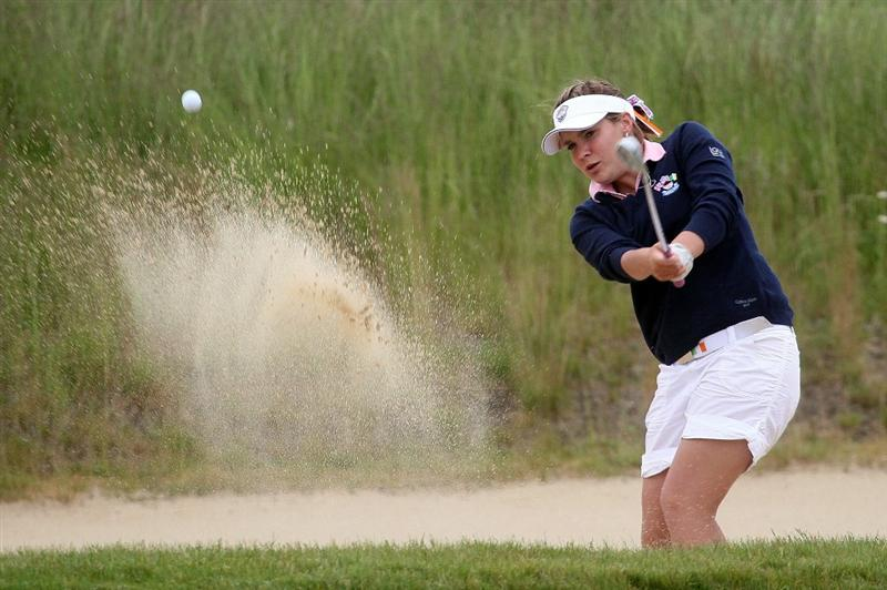 MANCHESTER, MA - JUNE 12: Rachel Jennings of Great Britain and Ireland works out of a bunker in Foursomes competition during the second day of the 2010 Curtis Cup Match at the Essex Country Club on June 12, 2010 in Manchester, Massachusetts. (Photo by Jim Rogash/Getty Images)