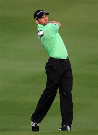 BAHRAIN, BAHRAIN - JANUARY 27:  Sergio Garcia of Spain plays his second shot at the 14th hole during the first round of the 2011 Volvo Champions held at the Royal Golf Club on January 27, 2011 in Bahrain, Bahrain.  (Photo by David Cannon/Getty Images)