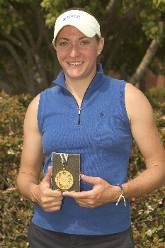 Duke's Brittany Lang poses with her medal for winning the individual championship at the 2005 ACC Women's Golf Championship at Carmel Country Club in Charlotte, NC, April 17, 2005.  This was the second straight individual title for Lang, who shot a final round of -2 70 for a three day total of +3 219.Photo by Brian A.  Westerholt/WireImage.com