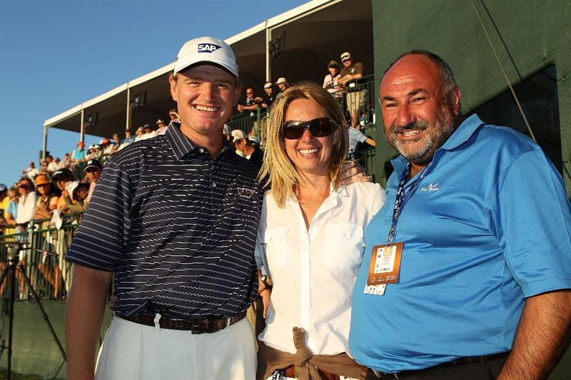 DORAL, FL - MARCH 14:  Ernie Els of South Africa poses with his wife Liezl and his manager Andrew 'Chubby' Chandler on the 18th hole after winning the 2010 WGC-CA Championship at the TPC Blue Monster at Doral on March 14, 2010 in Doral, Florida.  (Photo by Scott Halleran/Getty Images)