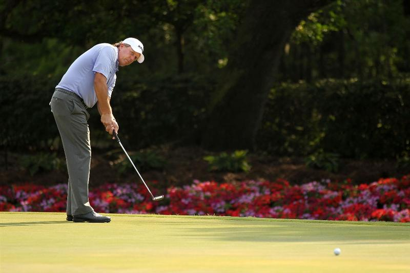 PONTE VEDRA BEACH, FL - MAY 13:  Phil Mickelson putts on the 14th hole during the second round of THE PLAYERS Championship held at THE PLAYERS Stadium course at TPC Sawgrass on May 13, 2011 in Ponte Vedra Beach, Florida.  (Photo by Mike Ehrmann/Getty Images)