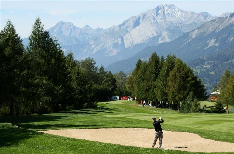 CRANS, SWITZERLAND - SEPTEMBER 02:  Soren Kjeldsen of Denmark plays out of the fairway bunker on the ninth hole during the first round of The Omega European Masters at Crans-Sur-Sierre Golf Club on September 2, 2010 in Crans Montana, Switzerland.  (Photo by Warren Little/Getty Images)