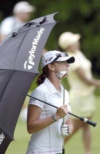 Helen Alfredsson takes shelter under an umbrella as rain begins to fall during the third round of the LPGA Florida's Natural Charity Championship on Saturday, April 22, 2006, at Eagle's Landing Country Club in Stockbridge, Georgia.Photo by Grant Halverson/WireImage.com