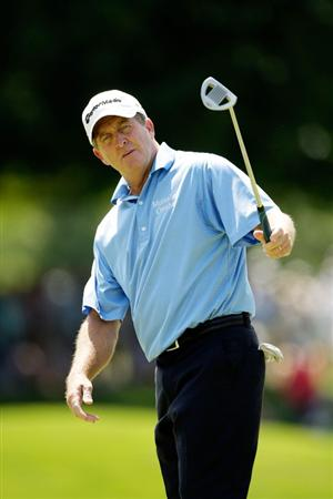 CARMEL, IN - AUGUST 2:  Fred Funk of the USA reacts as he makes a putt for birdie on the 4th hole during the final round of the 2009 U.S. Senior Open on August 2, 2009 at Crooked Stick Golf Club in Carmel, Indiana.  (Photo by Jamie Squire/Getty Images)