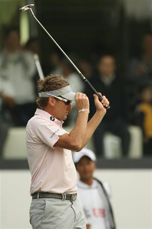 HONG KONG - NOVEMBER 20:  Ian Poulter of England celebrates on the 18th green during day three of the UBS Hong Kong Open at The Hong Kong Golf Club on November 20, 2010 in Hong Kong, Hong Kong.  (Photo by Ian Walton/Getty Images)