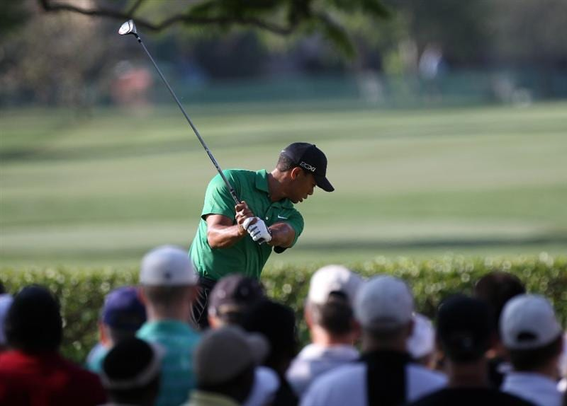 ORLANDO, FL - MARCH 25:  Tiger Woods plays a shot on the 15th hole during the second round of the Bay Hill Invitational presented by MasterCard at the Bay Hill Club and Lodge on March 25, 2011 in Orlando, Florida.  (Photo by Sam Greenwood/Getty Images)