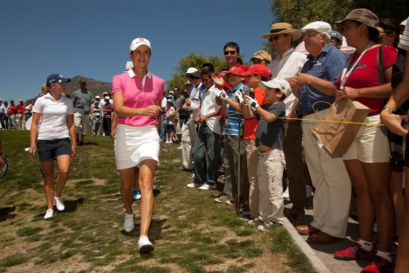 MORELIA, MEXICO - MAY 2: Lorena Ochoa of Mexico walks past cheering fans during the fourth round of the Tres Marias Championship at the Tres Marias Country Club on May 2, 2010 in Morelia, Mexico. (Photo by Darren Carroll/Getty Images)