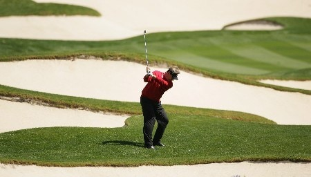 ORLANDO, FL - MARCH 25:  John Cook of the USA and the Isleworth team plays his second shot into the third green during the second day of the Tavistock Cup at Isleworth Golf and Country Club on March 25, 2008 in Orlando, Florida.  (Photo by Warren Little/Getty Images)