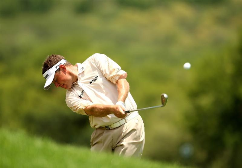 SUN CITY, SOUTH AFRICA - DECEMBER 06:  Lee Westwood of England plays into the 6th green during the third round of the Nedbank Golf Challenge at the Gary Player Country Club on December 6, 2008 in Sun City, South Africa.  (Photo by Richard Heathcote/Getty Images)