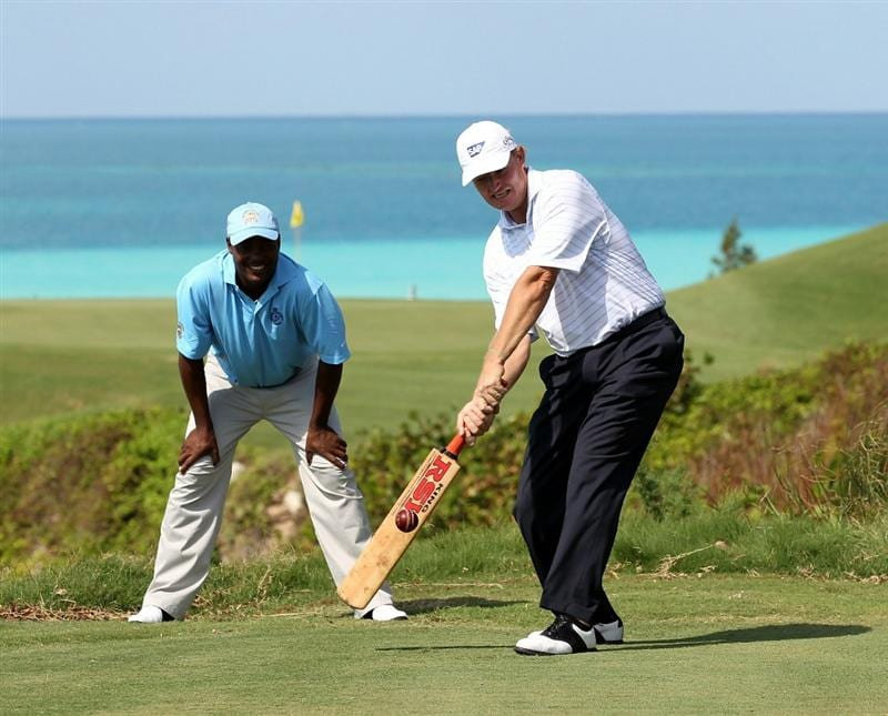SOUTHAMPTON, BERMUDA - OCTOBER 18:  Ernie Els of South Africa tries his hand at cricket with former test star Brian Lara keeping wicket during the pro-am event prior to the PGA Grand Slam of Golf at Port Royal Golf Course on October 18, 2010 in Southampton, Bermuda.  (Photo by Ross Kinnaird/Getty Images)