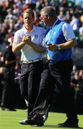 NEWPORT, WALES - OCTOBER 04:  Luke Donald of Europe is congratulated by Vice Captain Darren Clarke after he won his match on the 18th green in the singles matches during the 2010 Ryder Cup at the Celtic Manor Resort on October 4, 2010 in Newport, Wales.  (Photo by David Cannon/Getty Images)