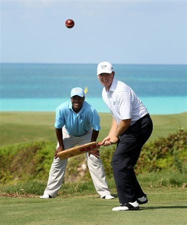 SOUTHAMPTON, BERMUDA - OCTOBER 18: Ernie Els of South Africa tries his had at cricket with former test star Brian Lara keeping wicket during the pro-am event prior to the PGA Grand Slam of Golf at Port Royal Golf Course on October 18, 2010 in Southampton, Bermuda.  (Photo by Ross Kinnaird/Getty Images)