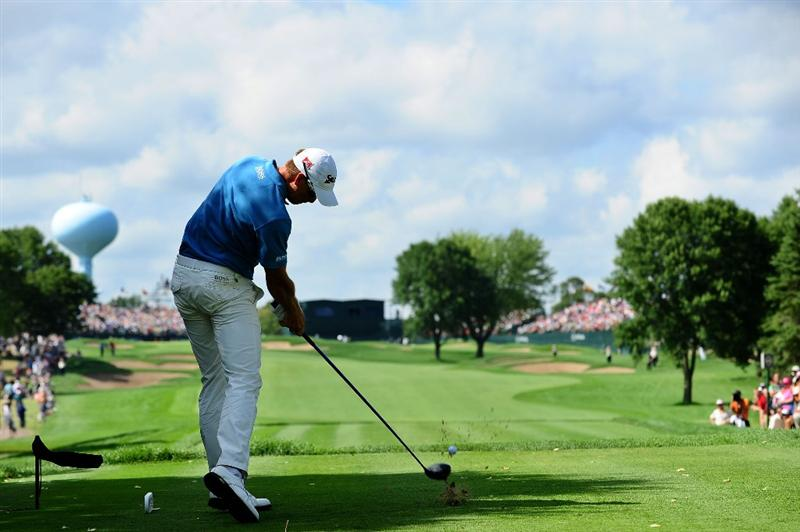 CHASKA, MN - AUGUST 16:  Henrik Stenson of Sweden hits his tee shot on the ninth hole during the final round of the 91st PGA Championship at Hazeltine National Golf Club on August 16, 2009 in Chaska, Minnesota.  (Photo by Stuart Franklin/Getty Images)