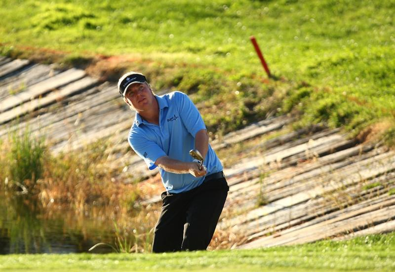 MADRID, SPAIN - OCTOBER 11:  Ross McGowan of England in action on the 18th hole during the Final Round of the Madrid Masters at Cantro Nacional De Golf on October 9, 2009 in Madrid, Spain.  (Photo by Ian Walton/Getty Images)