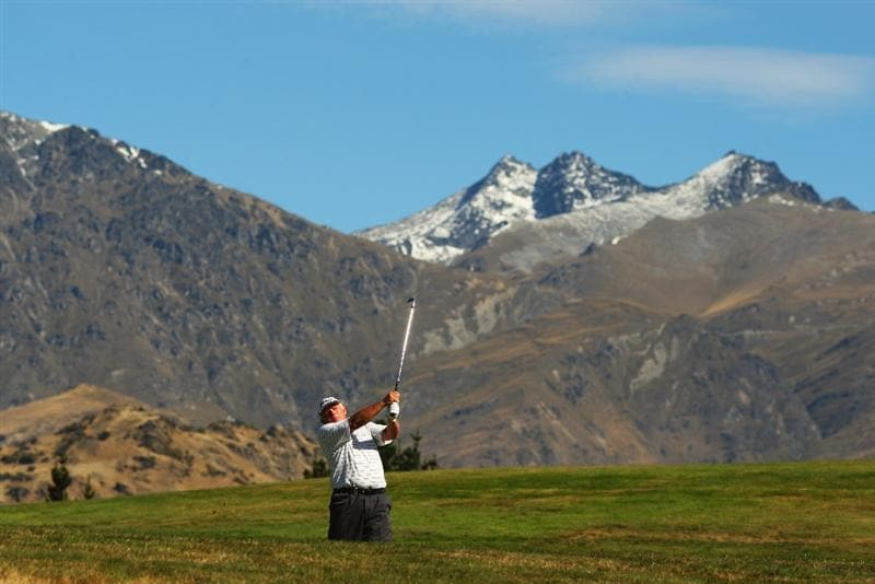 QUEENSTOWN, NEW ZEALAND - MARCH 15: Peter Senior of Australia plays plays an approach shot on the 18th during day four of the New Zealand Men's Open Championship at The Hills Golf Club on March 15, 2009 in Queenstown, New Zealand.  (Photo by Phil Walter/Getty Images)
